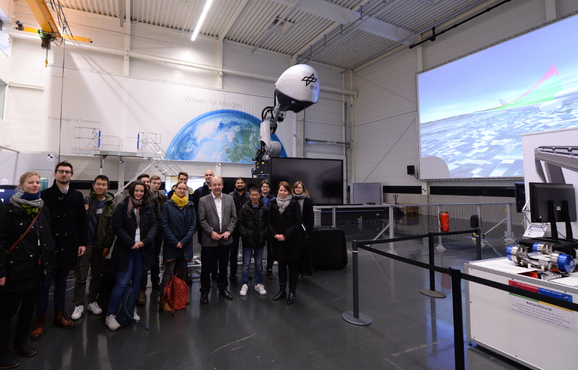 Participants with Dr Johann Bals (6th from right) in the Innovation Lab at the Institute of System Dynamics and Control